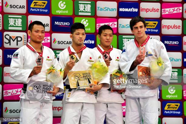 Gold medalist Shohei Ono of Japan celebrates with silver medalist Masashi Ebinuma of Japan and bronze medalists Arata Tatsukawa of Japan and Tommy...