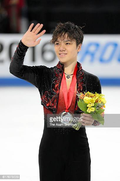 Gold medalist Shoma Uno of Japan celerbates on the podium at the medal ceremony for the Men Singles during day three of the 2016 Progressive Skate...