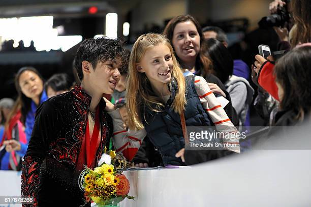 Gold medalist Shoma Uno of Japan poses for fans after the medal ceremony for the Men Singles during day three of the 2016 Progressive Skate America...