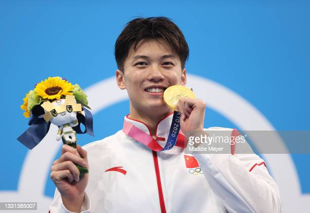 Gold medalist Shun Wang of Team China reacts on the podium during the medal ceremony for the Men's 200m Individual Medley Final on day seven of the...