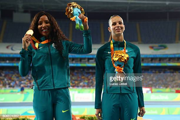 Gold medalist Silvania Costa de Oliveira of Brazil and bronze medalist Lorena Salvation Spoladore of Brazil pose on the podium at the medal ceremony...