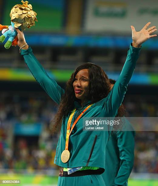 Gold medalist Silvania Costa de Oliveira of Brazil poses on the podium at the medal ceremony for Women's Long Jump - T11 during day 9 of the Rio 2016...