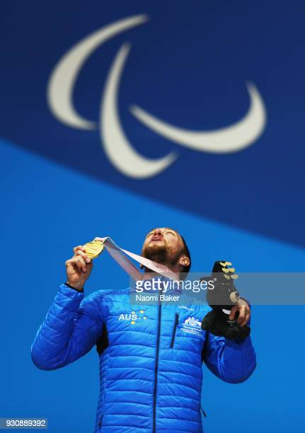 Gold Medalist Simon Patmore of Australia celebrates during the medal ceremony for the Men's Snowboard Cross SBUL during day three of the PyeongChang...