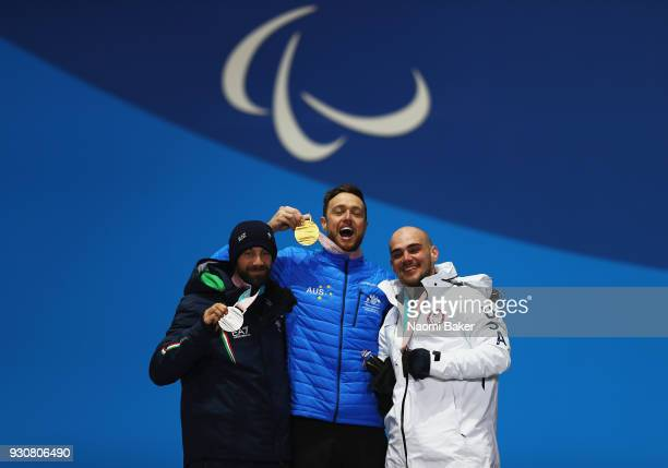 Gold Medalist Simon Patmore of Australia celebrates with Silver medallist Manuel Pozzerle of Italy and Bronze medallist Mike Minor of USA during the...