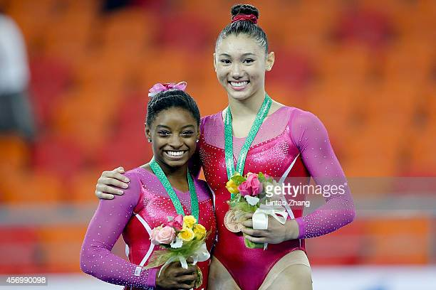 Gold medalist Simone Biles and Bronze medalist Kyla Ross of United States celebrate during the medal ceremony after the Women's All Around Final in...