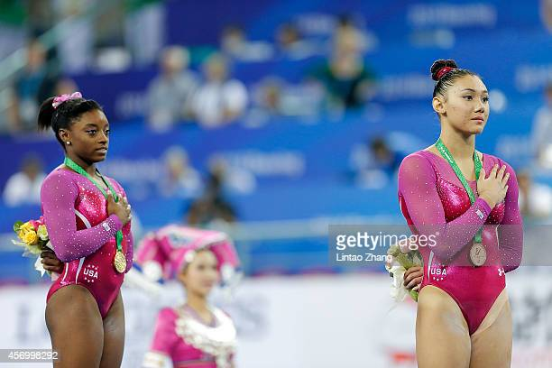 Gold medalist Simone Biles and Bronze medalist Kyla Ross of United States celebrates during the medal ceremony after the Women's AllAround Final in...