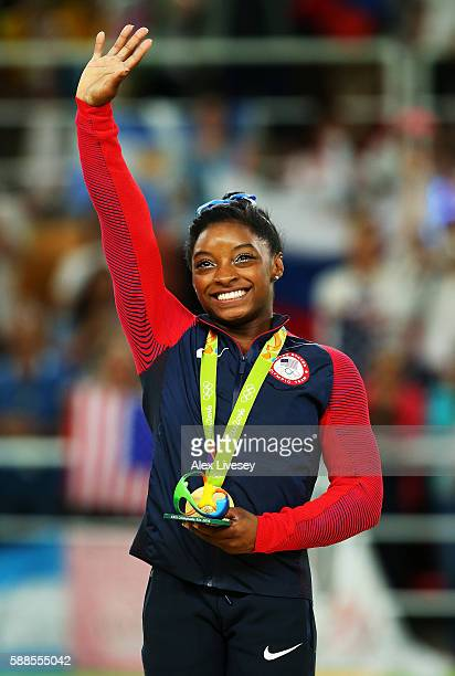 Gold medalist Simone Biles of the United States celebrates on the podium at the medal ceremony for the Women's Individual All Around on Day 6 of the...