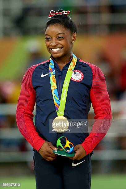 Gold medalist Simone Biles of the United States celebrates on the podium at the medal ceremony for Women's Vault on Day 9 of the Rio 2016 Olympic...