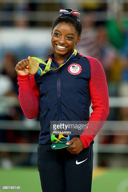 Gold medalist Simone Biles of the United States celebrates on the podium at the medal ceremony for the Women's Floor on Day 11 of the Rio 2016...