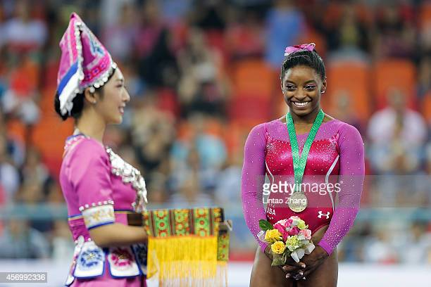 Gold medalist Simone Biles of United States celebrates during the medal ceremony after the Women's AllAround Final in day four of the 45th Artistic...