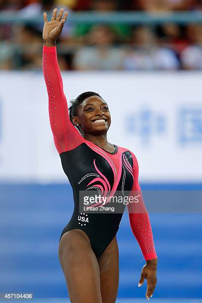 Gold medalist Simone Biles of United States celebrates during the medal ceremony after Women's Floor Exercise Final on day six of the 45th Artistic...