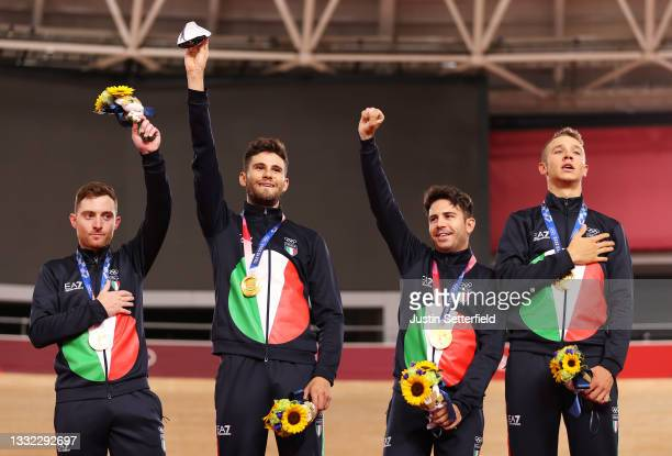 Gold medalist Simone Consonni, Filippo Ganna, Francesco Lamon and Jonathan Milan of Team Italy, pose on the podium during the medal ceremony after...