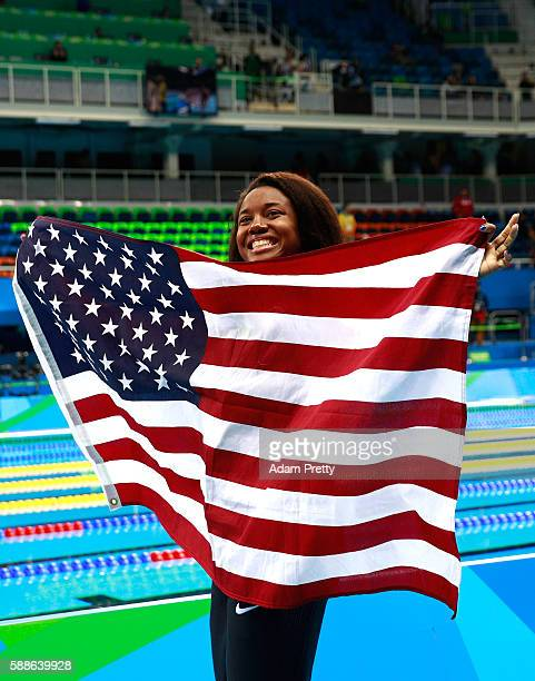 Gold medalist Simone Manuel of the United States celebrates during the medal ceremony for the Women's 100m Freestyle Final on Day 6 of the Rio 2016...