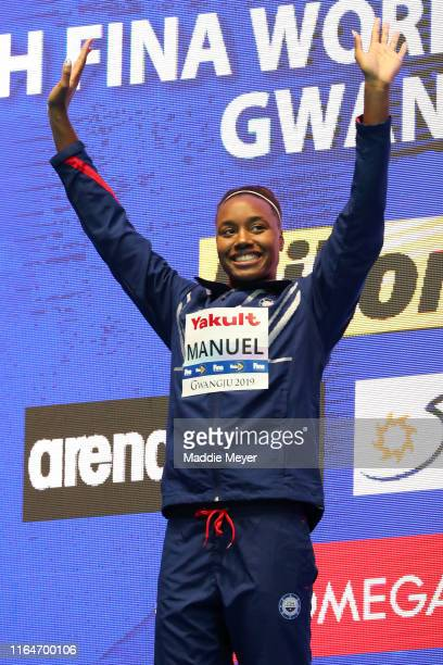 Gold medalist Simone Manuel of the United States celebrates on the podium at the medal ceremony for the Women's 50m Freestyle on day eight of the...