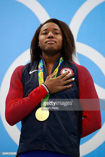 Gold medalist Simone Manuel of the United States celebrates on the podium during the medal ceremony for the Women's 100m Freestyle Final on Day 6 of...