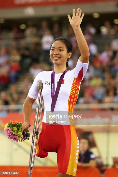 Gold medalist Sini Zeng of China poses on the podium during the victory ceremony for the Women's Individual C123 Pursuit Cycling on day 1 of the...
