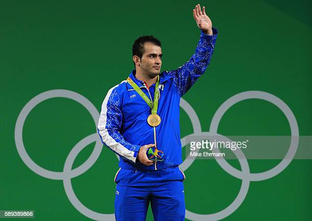 Gold medalist Sohrab Moradi of the Islamic Republic of Iran stands on the podium during the medal ceremony for the Weightlifting Men's 94kg on Day 8...
