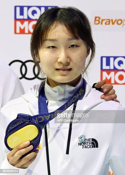 Gold medalist South Korea's Choi Minjeong celebrates on the podium after the final of the Women's 500m event of the ISU Short Track Speed Skating...