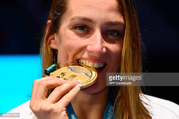 Gold medalist Spain's Mireia Belmonte celebrates on the podium of the women's 200m butterfly event during the swimming competition at the 2017 FINA...