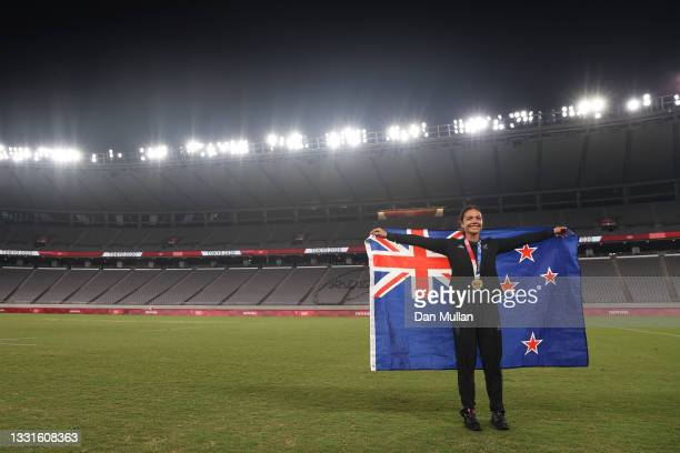 Gold medalist Stacey Fluhler of Team New Zealand celebrates with her gold medal after the Women's Rugby Sevens Medal Ceremony on day eight of the...