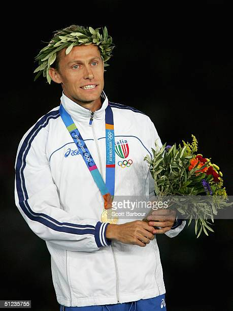 Gold medalist Stefano Baldini of Italy celebrates on the podium during the medal ceremony of the men's marathon on August 29, 2004 during the Athens...