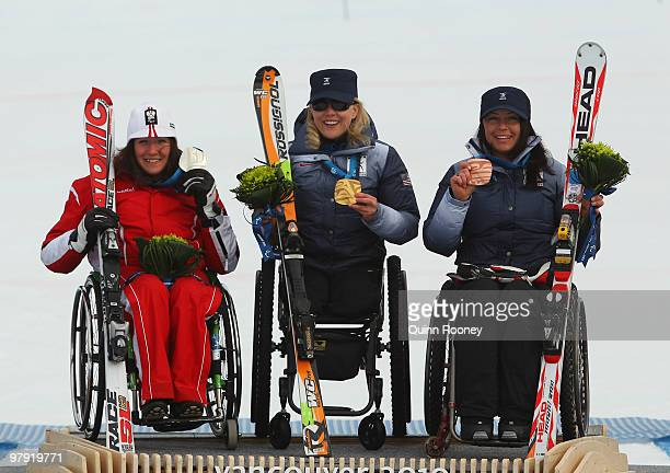 Gold medalist Stephani Victor of USA celebrates with silver medalist Claudia Loesch of Austria and bronze medalist Alana Nichols of USA at the medal...