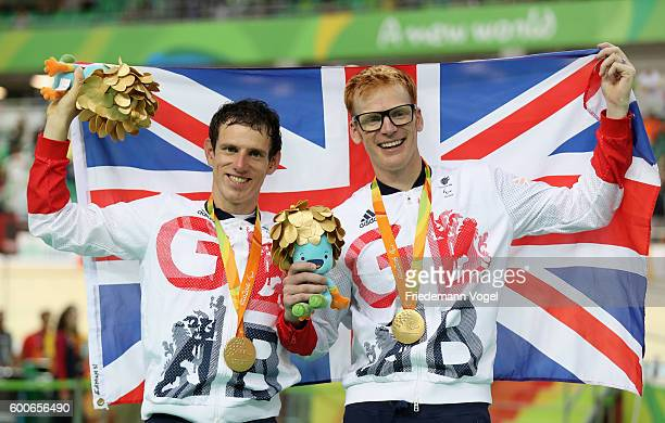 Gold medalist Steve Bate and Adam Duggleby celebrate on the podium at the medal ceremony for the men's B 4000m individual pursuit track cycling on...