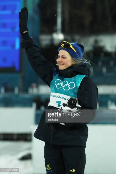 Gold medalist Stina Nilsson of Sweden celebrates during the victory ceremony for the CrossCountry Ladies' Sprint Classic Final on day four of the...