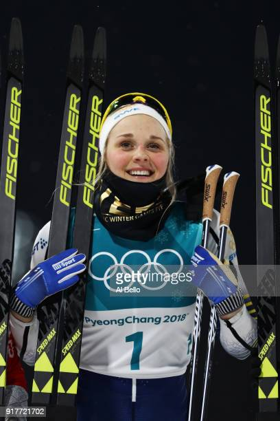 Gold medalist Stina Nilsson of Sweden celebrates winning during the CrossCountry Ladies' Sprint Classic Final on day four of the PyeongChang 2018...