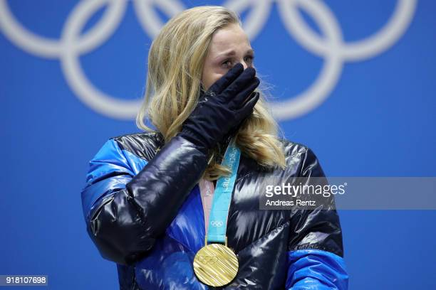 Gold medalist Stina Nilsson of Sweden reacts during the medal ceremony for the CrossCountry Ladies' Sprint Classic on day five of the PyeongChang...