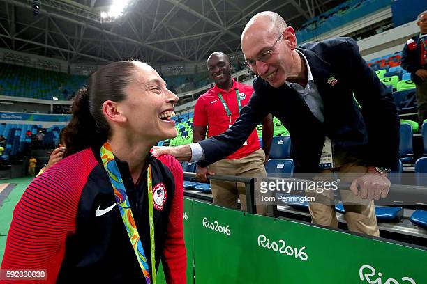Gold medalist Sue Bird of United States is congratulated by NBA commissioner Adam Silver after the Women's Basketball competition on Day 15 of the...