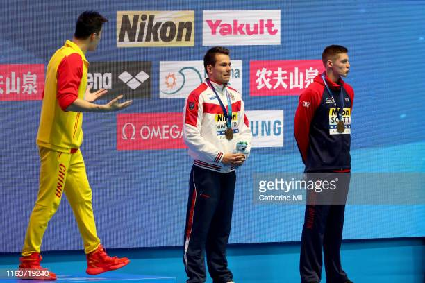 Gold medalist Sun Yang of China and bronze medalists Martin Malyutin of Russia and Duncan Scott of Great Britain interact during the medal ceremony...