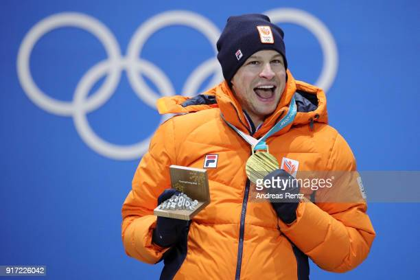 Gold medalist Sven Kramer of the Netherlands waves during the medal ceremony for the Men's 5000m speed skating at Medal Plaza on February 12 2018 in...