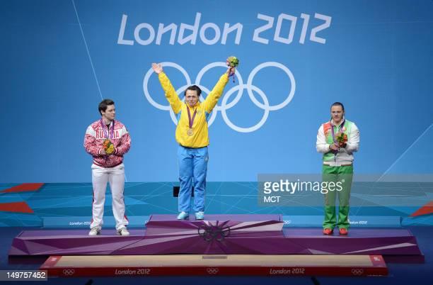 Gold medalist Svetlana Podobedova of Kazakhstan center celebrates between silver medalist Natalya Zabolotnaya of Russia left and bronze medalist...