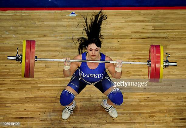 Gold medalist Svetlana Podobedova of Kazakhstan competes in the women's 75kg weightlifting contest at the 16th Asian Games in Guangzhou on November...