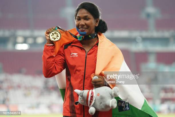 Gold medalist Swapna Barman of India celebrates during the medal ceremony for the women's hepatatlhon on day twelve of the Asian Games on August 30...