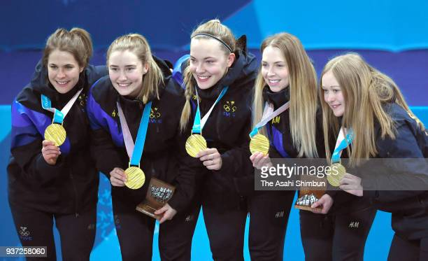 Gold medalist Sweden pose for photographs on the podium at the medal ceremony for the Women's Curling on day sixteen of the PyeongChang 2018 Winter...