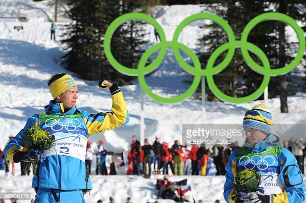 Gold medalist Sweden's Marcus Hellner and Sweden's bronze medalist Johan Olsson react on the podium after the men's Cross Country Skiing 30km pursuit...