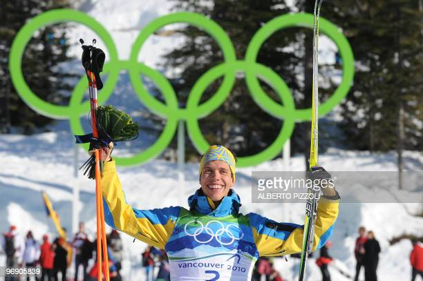 Gold medalist Sweden's Marcus Hellner stands on the podium after the men's Cross Country Skiing 30km pursuit final at the Whistler Olympic Park...