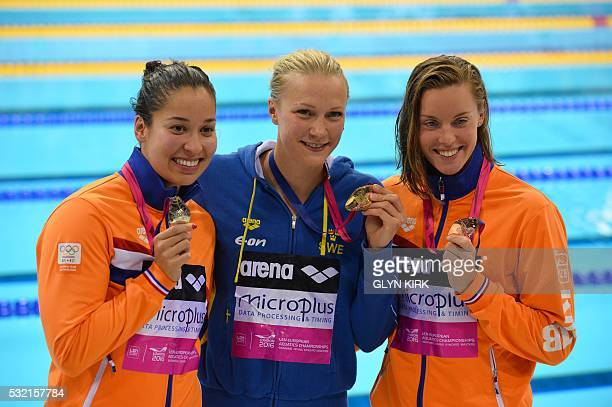 Gold medalist Sweden's Sarah Sjoestroem poses for a photograph with silver medalist Netherland's Ranomi Kromowidjojo and bronze medalist Netherland's...