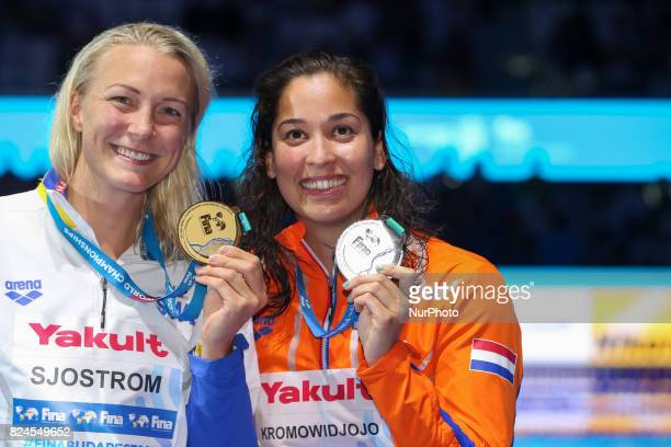 Gold medalist Sweden's Sarah Sjostrom and silver medalist Netherlands' Ranomi Kromowidjojo celebrate on the podium of the final of the women's 50m...