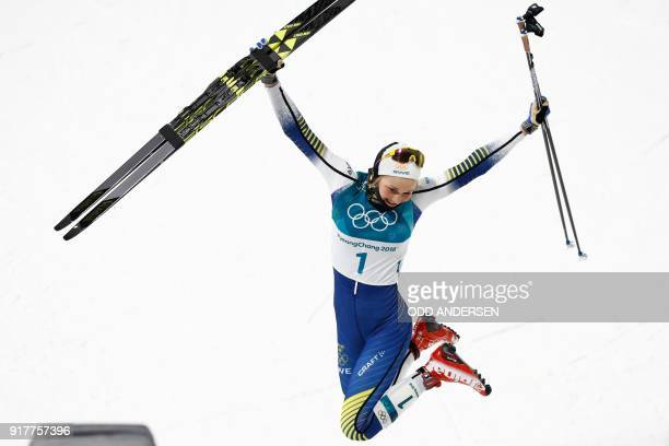 TOPSHOT Gold medalist Sweden's Stina Nilsson reacts on the podium during the victory ceremony in the women's crosscountry individual sprint classic...