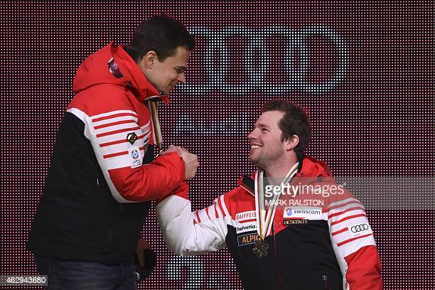 Gold medalist Switzerland's Patrick Kueng is congratulated by bronze medalist Switzerland's Beat Feuz during the medal ceremony of the 2015 World...