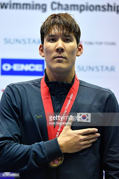 Gold medalist Taehwan Park of South Korea stands for his national antem in Men's 400m Freestyle final during the 10th Asian Swimming Championships...