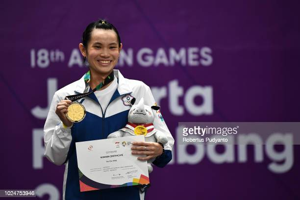 Gold medalist Tai Tzuying of Chinese Taipei celebrates on the podium during Women's Singles victory ceremony on day ten of the Asian Games on August...