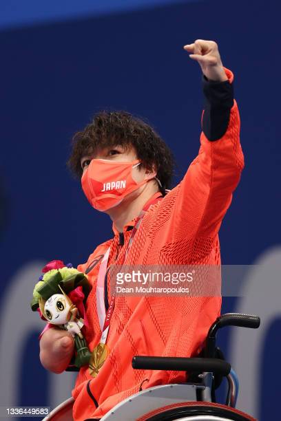 Gold medalist Takayuki Suzuki of Team Japan celebrates on the podium at the medal ceremony for the Men's 100m Freestyle - S4 on day 2 of the Tokyo...