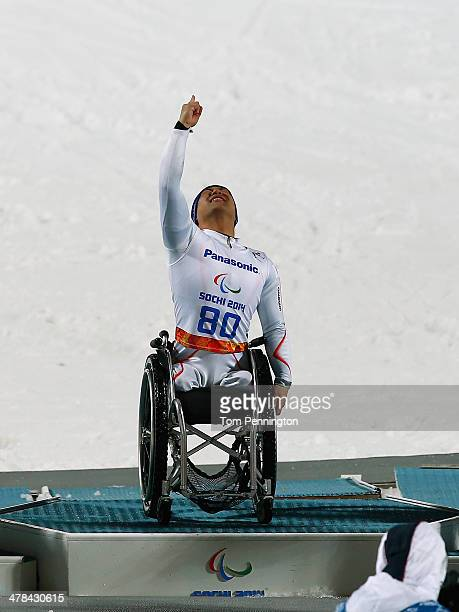 Gold medalist Takeshi Suzuki of Japan celebrates during the flower ceremony in the Men's Slalom 2nd Run Sitting during day six of Sochi 2014...