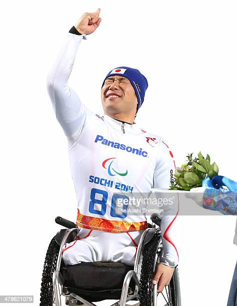 Gold medalist Takeshi Suzuki of Japan celebrates during the flower ceremony in the Men's Slalom Sitting during day six of Sochi 2014 Paralympic...