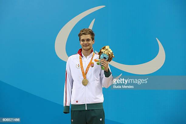Gold medalist Tamas Toth of Hungary celebrates on the podium at the medal ceremony for the Men's 100m Backstroke S9 Final on day 9 of the Rio 2016...