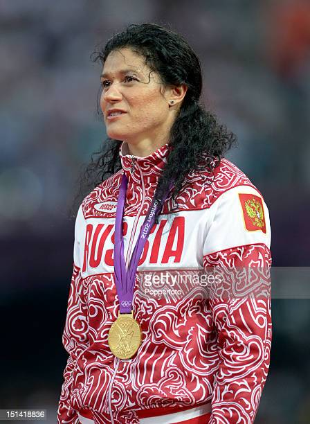 Gold medalist Tatyana Lysenko of Russia poses on the podium during the medal ceremony for the Women's Hammer Throw on Day 15 of the London 2012...
